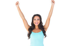 Casual brunette cheering at camera Royalty Free Stock Image