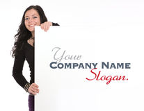 Casual brunette holding a vertical signboard Stock Images