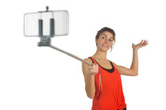 Casual brunette using selfie stick Stock Images
