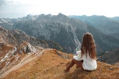 Casual brunette woman sitting on bench holding ice heart enjoyin Royalty Free Stock Image