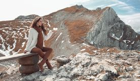 Casual brunette woman sitting on bench holding ice heart enjoyin stock image