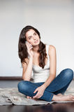 Casual brunette girl holding cell phone Stock Images