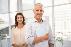 Casual business colleagues smiling at camera Stock Photos