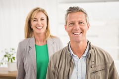 Casual business colleagues smiling at camera. Portrait of casual business colleagues smiling at camera in the office stock images