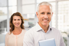 Casual business colleagues smiling at camera Royalty Free Stock Image