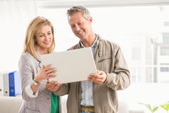 Casual business colleagues working with laptop Royalty Free Stock Photography