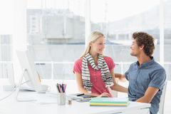 Casual business couple in a bright office Royalty Free Stock Images