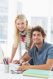 Casual business couple using computer in bright office Stock Photo