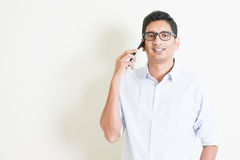 Casual business Indian male calling on smartphone Royalty Free Stock Image