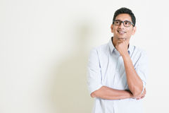 Casual business Indian male thinking Stock Images