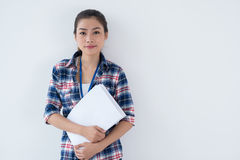 Casual business. Isolated portrait of a young lovely businesswoman in casual with paper in hands Royalty Free Stock Images