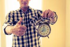 Casual business man alarm clock thumb up. Casual business man alarm clock and thumb up Royalty Free Stock Photos