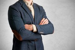Casual Business Man. With arms crossed in a grey background Stock Images
