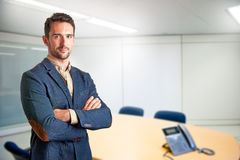 Casual Business Man. With arms crossed in a meeting room Royalty Free Stock Images