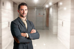 Casual Business Man. With arms crossed in a white background Stock Photos