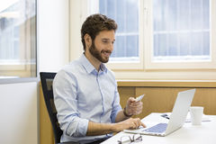 Casual business man paying online with credit card. ecommerce Stock Photography