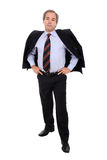 Casual business man standing. With coat over his shoulders isolated over white Stock Photos