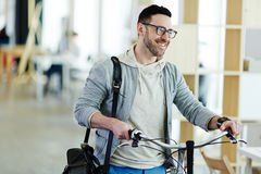 Casual Business Man Taking Bicycle to Office Royalty Free Stock Image