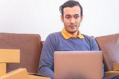 Casual Business man working on computer on sofa. Casual Business man is working on computer on sofa Stock Photos
