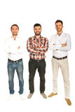 Casual business men. Casual three business men standing in a line with arms folded isolated on white background Royalty Free Stock Images