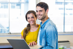 Casual business partners holding laptop Royalty Free Stock Photo