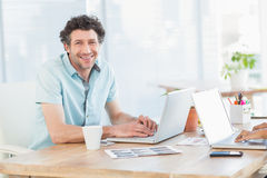 Casual business partners looking at laptop Royalty Free Stock Photo