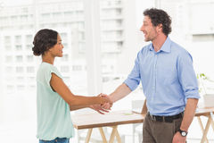 Casual business partners shaking their hands Royalty Free Stock Photos