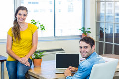 Casual business partners smiling at camera Stock Photos