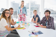 Casual business people around conference table in office Stock Photo