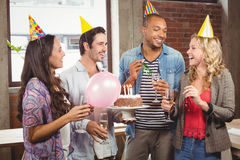 Casual business people celebrating birthday in office Royalty Free Stock Image