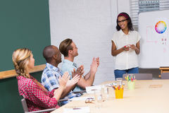 Casual business people clapping hands in meeting Royalty Free Stock Photography