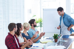 Casual business people clapping hands in meeting Royalty Free Stock Images