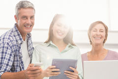 Casual business people with electronic devices Royalty Free Stock Photos