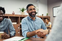 Casual business people shaking hands stock image