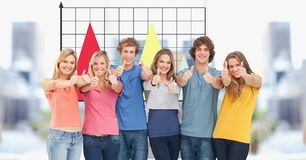 Casual business people showing thumbs up against graphs. Digital composite of Casual business people showing thumbs up against graphs Stock Image