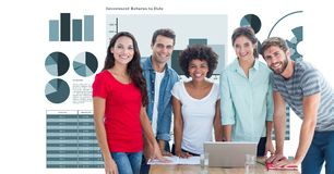 Casual business people smiling against graphs Stock Photos
