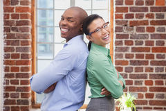 Casual business people smiling at camera Stock Images