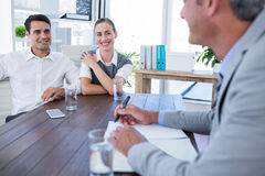 Casual business people speaking together Stock Photography