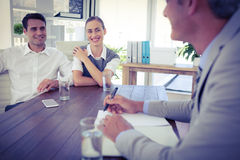 Casual business people speaking together Stock Photos
