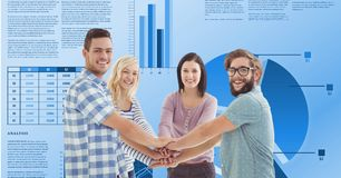 Casual business people stacking hands against graphs. Digital composite of Casual business people stacking hands against graphs Royalty Free Stock Photo