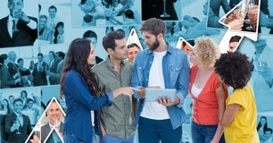 Casual business people with tablet PC discussing against graph Royalty Free Stock Images