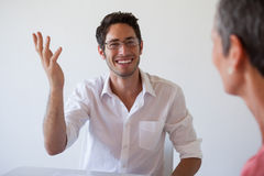 Casual business people talking at desk and smiling Stock Images