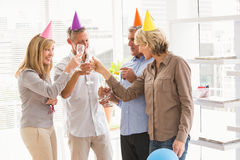 Casual business people toasting and celebrating birthday Stock Image