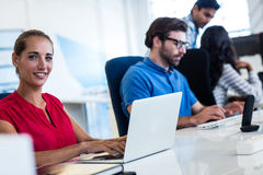 Casual business people using technology. In the office Royalty Free Stock Photos