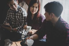 Business start up team discussing in a coffee cafe meetin Royalty Free Stock Images
