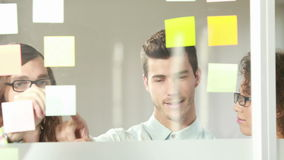 Casual business team brainstorming with sticky notes
