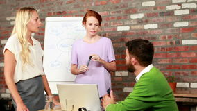 Casual business team brainstorming together stock video