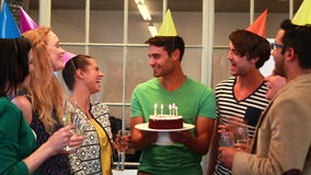 Casual business team celebrating birthday stock footage
