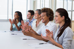 Casual business team clapping at presentation Royalty Free Stock Photo