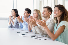 Casual business team clapping at presentation Royalty Free Stock Image